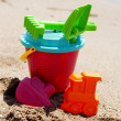 Plastic toys on the beach — Stock Photo