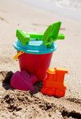 Plastic toys on the beach — Stock Photo
