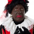 Scared Zwarte piet ( black pete) typical Dutch character — Stock Photo #3482032