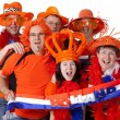 Group of Dutch soccer fans over white background — Stock Photo