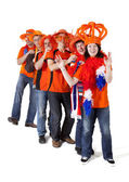 Group of Dutch soccer fans making polonaise over white backgroun — Stock Photo
