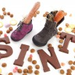 Chocolate letters and Shoes with carrots for Sinterklaas, a typi — Stock Photo