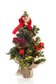 Plastic christmas tree with red decoration — Foto de Stock