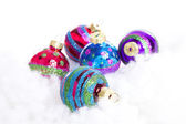 Colorful glitter Christmas balls over white background — Stock Photo