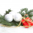 Stock Photo: Three white Christmas balls and pine tree over white background