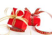 Two Christmas presents with big bow over white background — Stock Photo