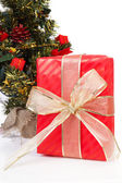 Christmas present with big golden bow on white background — Stock Photo