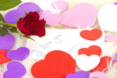 Card, red rose and hearts for Valentines — Stock Photo