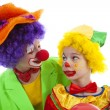 Children dressed as colorful funny clowns — Stock Photo #43148633