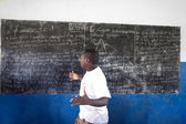 KINAZINI, KENYA - JULY-12: unidentified African teacher is showi — Stock Photo