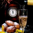 Traditional New Year's eve food and clock on midnight — Stock Photo #8417905