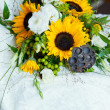 Wedding still life with bouquet and dress — Stock Photo