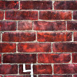 Brick wall with number 4 painted on it — Stock Photo