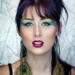 Beautiful young womin peacock inspired makeup — Stock Photo #20100737