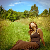 Young woman relaxing in the sun — Stock Photo