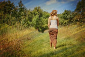 Young woman walking away — Stock Photo