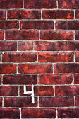 Brick wall with number 4 painted on it — Foto Stock