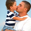 Man with a boy at the seaside - Stock Photo