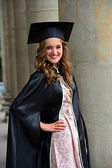 A university graduate in robes — Stock Photo