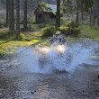 Travel through the mountains on ATVs — Stock Photo