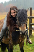Horseback riding in the mountains — Stock Photo