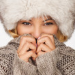 Portrait of young beautiful female wearing winter clothing and fur hat winter clothes, very warm and thickly clothed. — Stock Photo #41289321