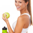 Beautiful young fitness woman happy smiling holding apple and water bottle. — Stock Photo #41289131