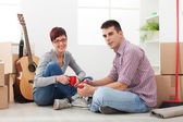 Happy couple in new apartment,making plans and make decisions — Stock Photo