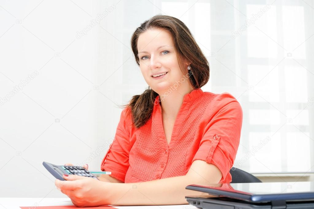 Portrait of real attractive businesswoman in her office — Stock Photo #12235415