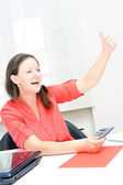 Real attractive businesswoman celebrating success in her office — Stock Photo