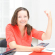 Real attractive businesswoman celebrating success in her office — Stock Photo #12832090