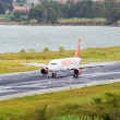 Passenger airplane landing to active runway — Stock Photo