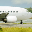 Passenger airplane waiting for takeoff clearance on the runway — Stock Photo
