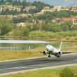 Passenger airplane takeoff from active runway — Stock Photo