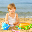 Toddler girl playing with her toys at beach — Stock Photo