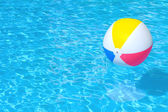 Inflatable ball floating in swimming pool — Foto de Stock
