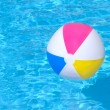 Inflatable ball floating in swimming pool — Stock Photo #21402991