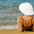 Real female beauty relaxing at beach — Stock Photo