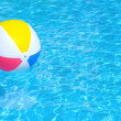 Inflatable ball floating in swimming pool — Stock Photo #24432161