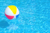 Inflatable ball floating in swimming pool — Stock Photo