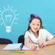 Smiling girl doing her school work — Stock Photo
