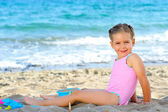 Toddler girl at beach — Stock Photo