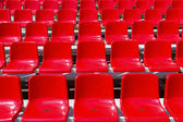 Rostrum with red seats — Stock Photo