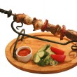 Shish kebab on a skewer — Stock Photo