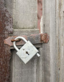 Wicket door with a padlock — Stock Photo