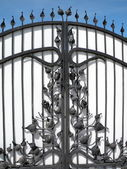 Metal gate decorated with flora — Stock Photo