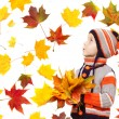Child in autumn leaves. Maple fall over white — Stock Photo