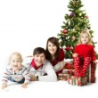 Christmas family and fir tree with gift boxes — Stock Photo