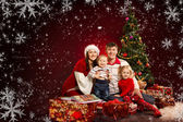 Christmas family of four persons and fir tree with gift boxes — Stock Photo