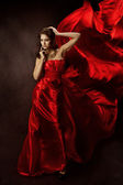 Woman in Red Dress with Flying Fabric, Gown Cloth flowing fluttering on wind — Stock Photo